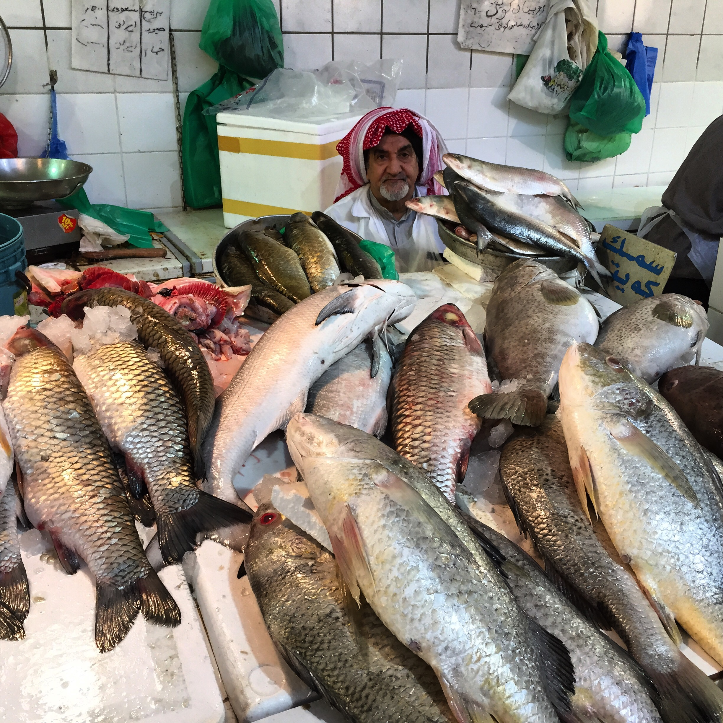 Fish vender in Kuwait market