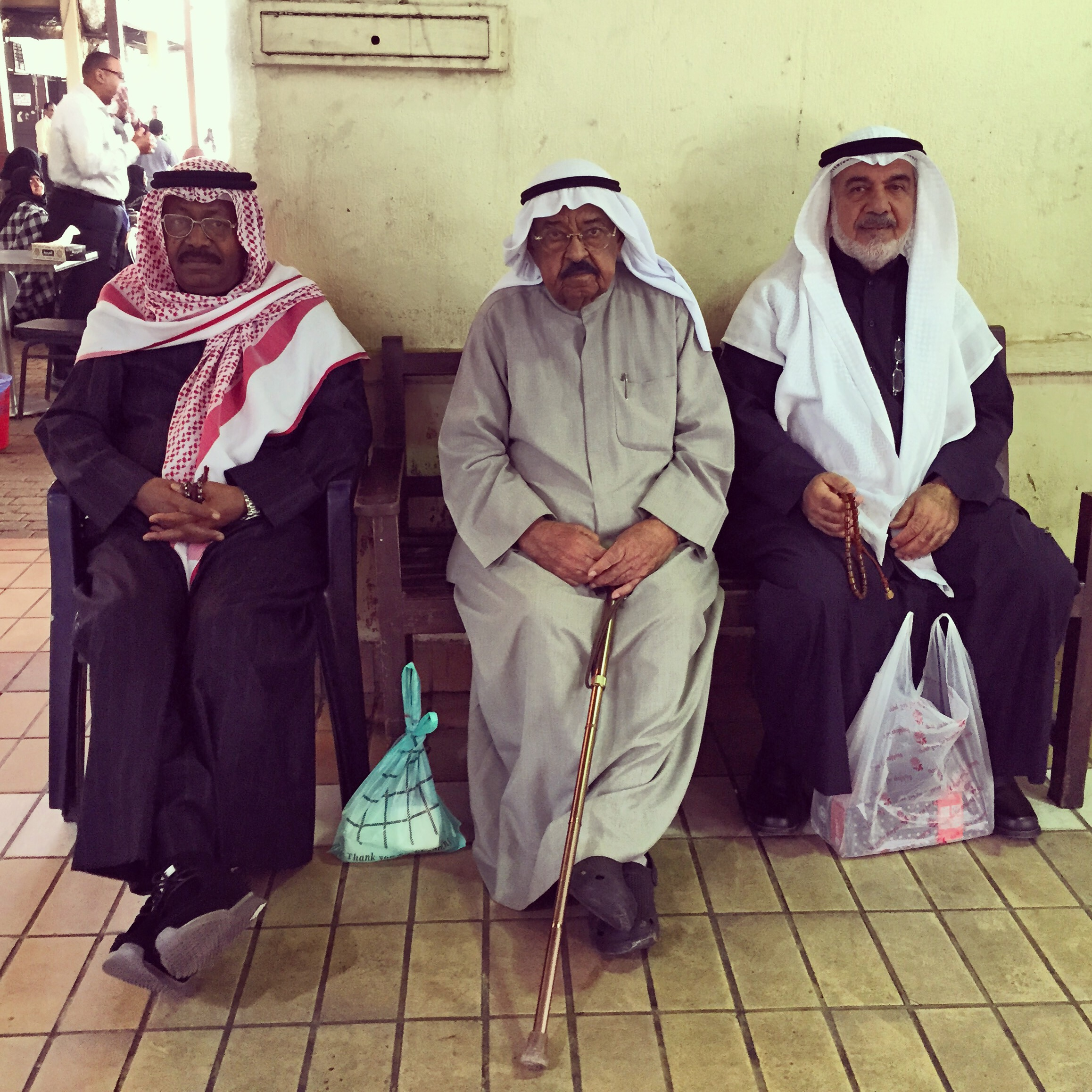 Buyers resting at traditional Kuwait market