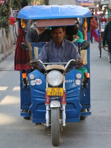 indian tuk-tuk driver in Delhi, India