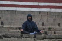 indian man meditating in Varanasi, India
