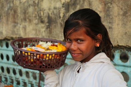 Indian child selling flowers in Rishikesh, India