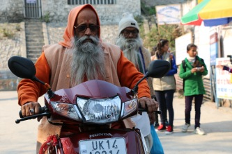 Indian sadhu with motorbike in Rishikesh, India